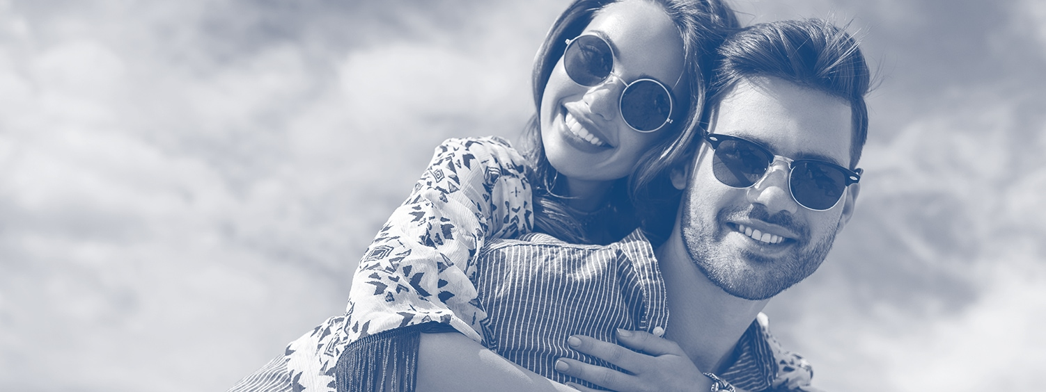 Picture of a couple smiling together in prescription sunglasses