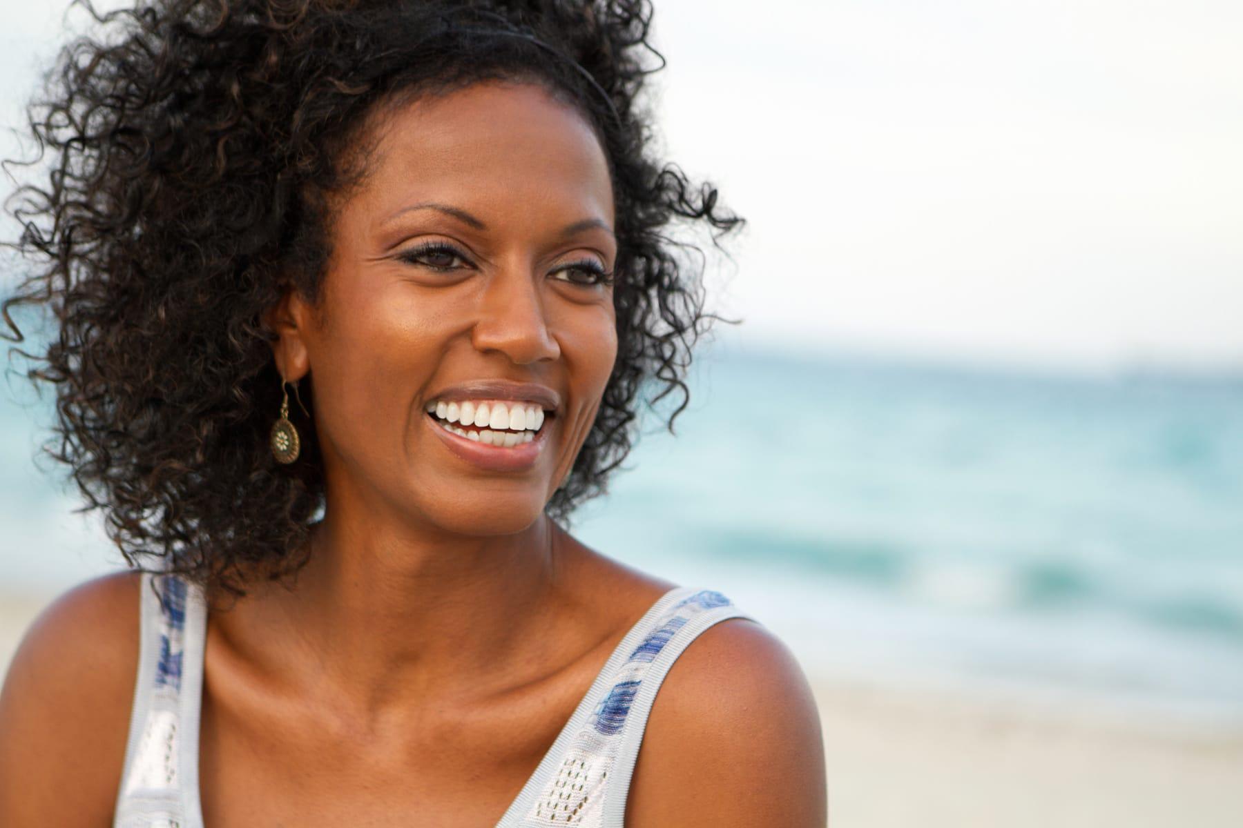 Beautiful mature woman smiling at the beach