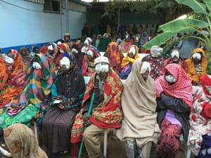 Group of Ethiopian individuals with bandages over their eyes after treatment