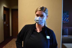Medical Eye Center employee wearing mask