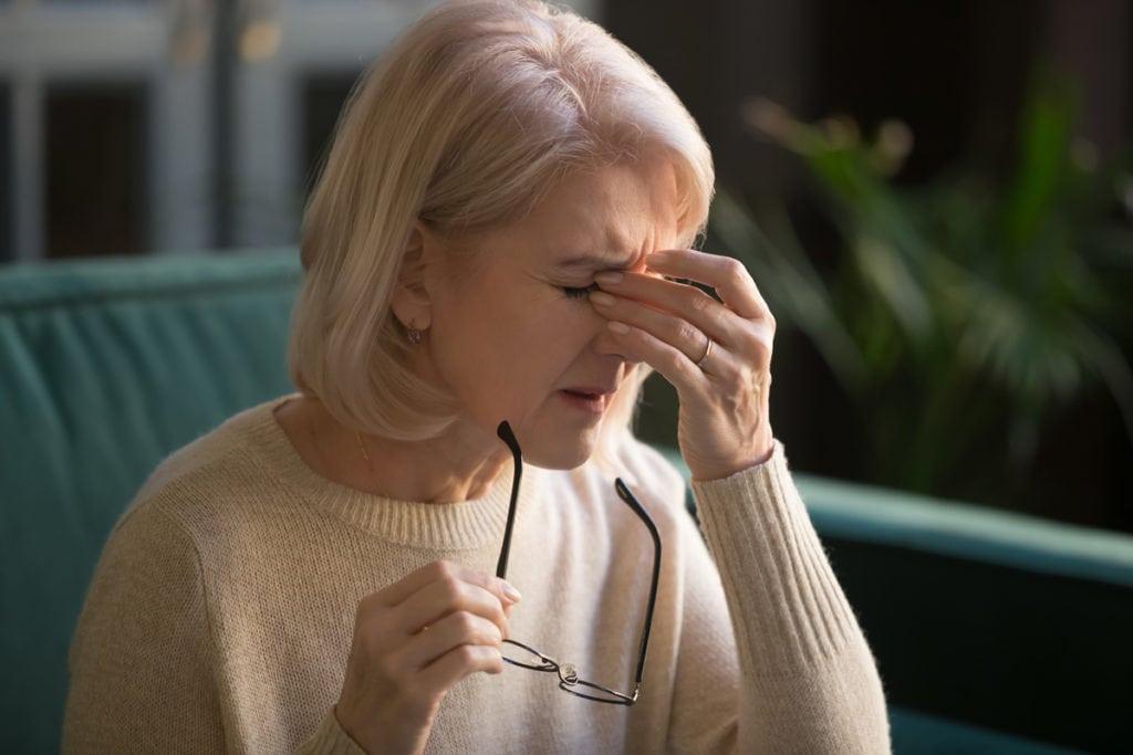 Woman with eye irritation